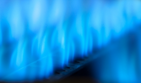 gas cooker: Close-up view of blue flames in gas boiler