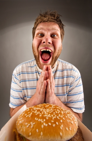 Portrait of happy man praying for fast food Stock Photo - 18304137