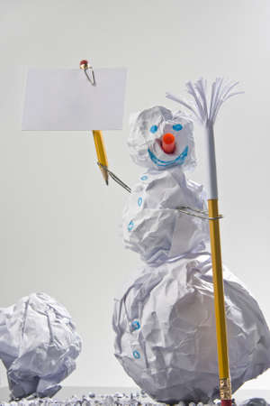 Paper snowman with sign. Office jokes photo