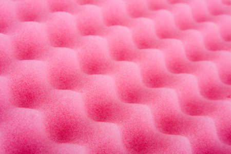 spongy: Close-up of pink cleaning sponge. Perspective view