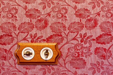 dimmer: Antique wooden light switch on the wall Stock Photo