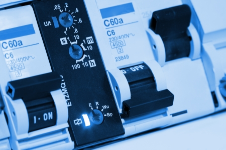fusebox: Electrical fuseboxes and components in control panels Stock Photo
