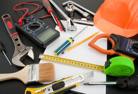 multimeter: Heap of tools. Multimeter, spanner, wrench, helmet and other Stock Photo