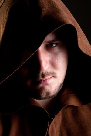 Portrait of pensive monk in the dark Stock Photo - 18304344