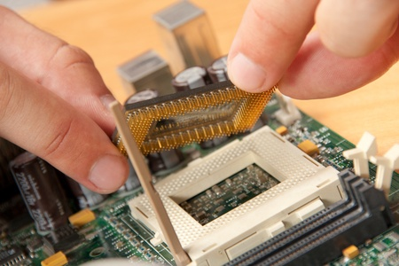 Installing computer processor to motherboard photo
