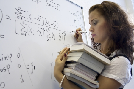 algebra: Heavy mathematics science  Student with heap of books Stock Photo