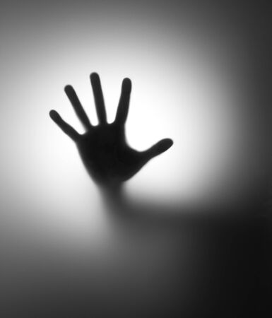 hope sign: A hand behind matted glass. In BW Stock Photo