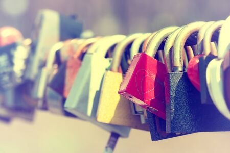 keylock: Close-up of padlocks on bridge railing Stock Photo