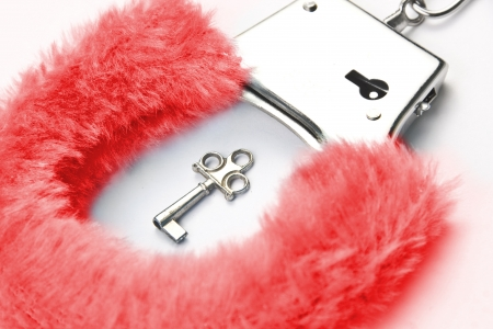 Red fluffy handcuffs with key Stock Photo - 18290176