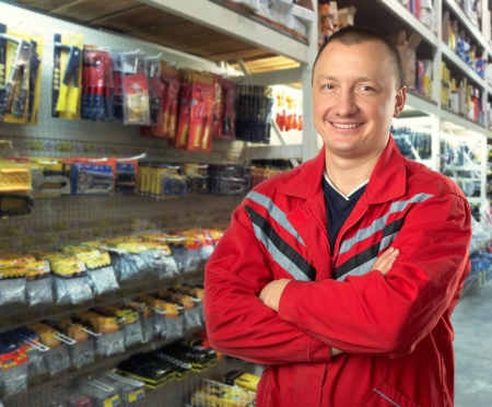 Happy technical adviser in tools shop photo