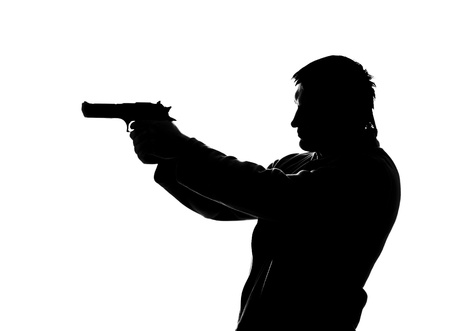 Silhouette of shooting man. Isolated on white photo
