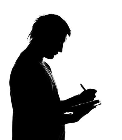 business writing: Silhouette of man writing business diary. Isolated on white