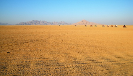 Four wheel motorbike rally in desert photo