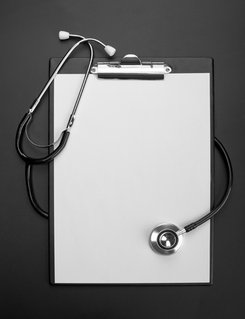 Empty clipboard with medical stethoscope photo