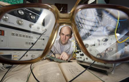 Pensive scientist working at vintage technological laboratory. View through nerd glasses Stock Photo - 18342011