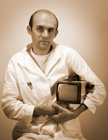 Portrait of pensive scientist with vintage monitor. Sepia toned photo