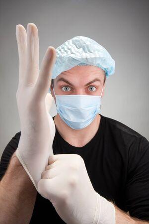 ander: Portrait of surprised dark surgeon wearing gloves