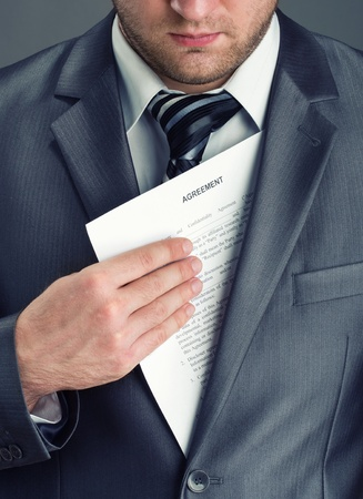 Serious businessman getting agreement from suit photo