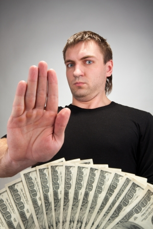 accepting: Portrait of man not accepting money bribe Stock Photo