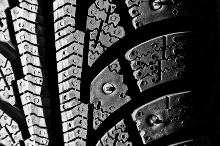 Close-up of new winter tire. In BW photo