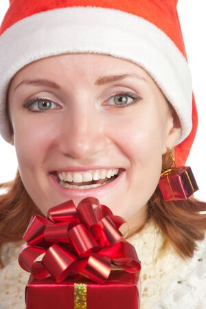 Happy smiling woman in christmas hat with gift. Isolated on white Stock Photo - 18341980