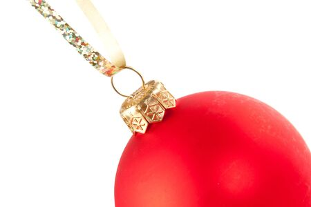 Hanging Christmas red bauble isolated on white photo
