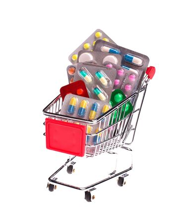 Small shopping cart full of pills isolated on white photo