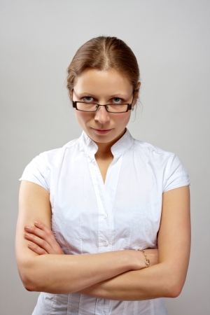 Portrait of beautiful business woman with crossed arms photo