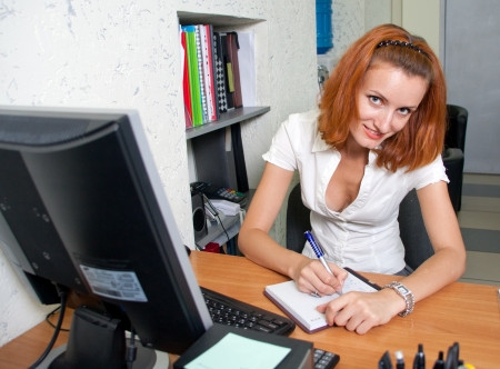 Cute business woman. What can I do for you? photo