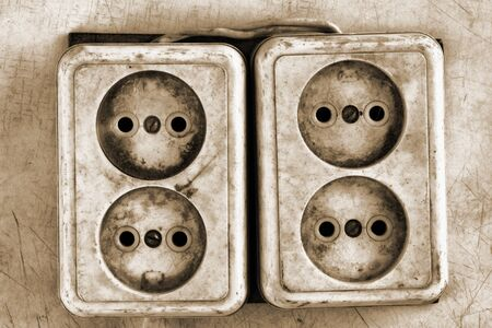 plug electric: Old dirty electrical outlets on the wall