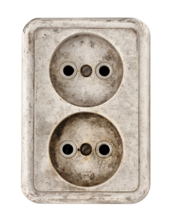 outlets: Closeup of old dirty double electrical outlet isolated on white
