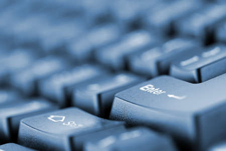 Close-up of computer keyboard. Toned in blue Stock Photo - 18364636