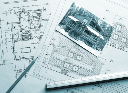 plan view: Architectural project of wooden mansion. Work drawings and photo on the table