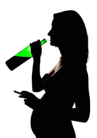 careless: Silhouette of careless pregnant woman with alcohol and cigarette Stock Photo