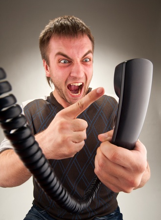 Portrait of mad office manager screaming to phone Stock Photo - 18359123