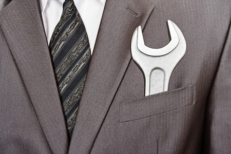 Big industrial spanner in businessman suit pocket Stock Photo - 18365674