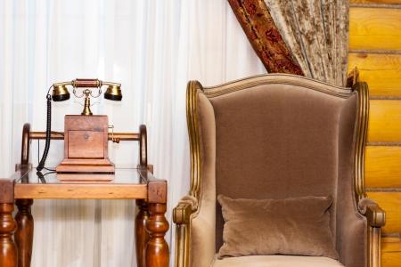 telefono antico: Interior Vintage - telefono e poltrona Archivio Fotografico