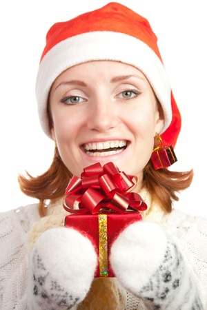 Happy smiling woman in christmas hat and mittens with gift. Isolated on white Stock Photo - 18358881