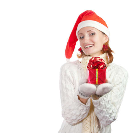 Happy smiling woman in christmas hat and mittens with gift. Isolated on white Stock Photo - 18358835
