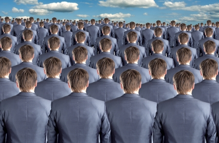 Rear view of many identical businessmen clones Stock Photo