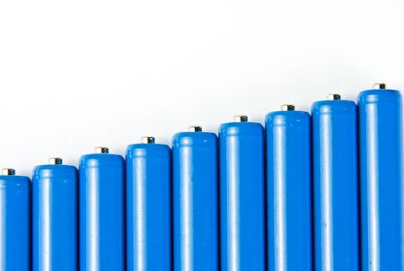 objects equipment: Row of blue batteries Stock Photo