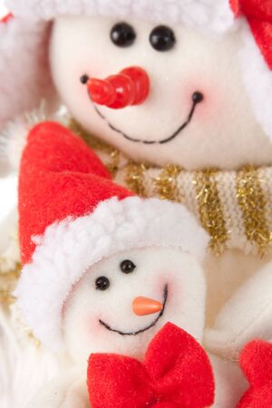 Happy smiling snowman kid with bow in mothers hands photo