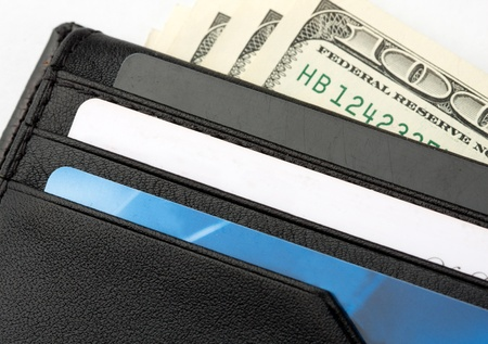 Black leather wallet with cards and money photo