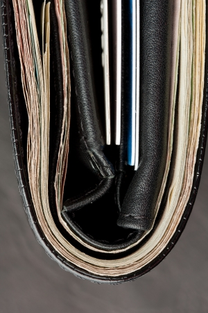 Close-up of black leather wallet with cards and money photo