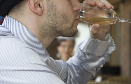 Man in cafe drinking wine photo