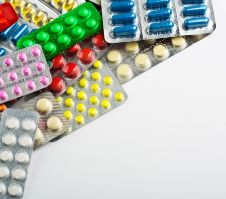 Various colorful pills background with copy space photo