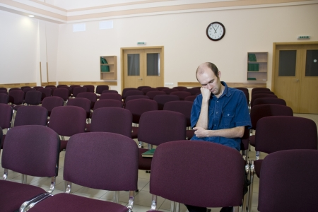 theater audience: Boring lecture. Alone sleeping student in empty auditorium