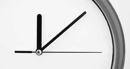 black clock hands: Close-up view of clock face. Time passing Stock Photo
