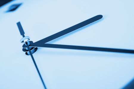 Close-up of clock hands. Toned in blue Stock Photo