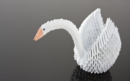 White Origami Swan On Grey Surface Close Up View Stock Photo